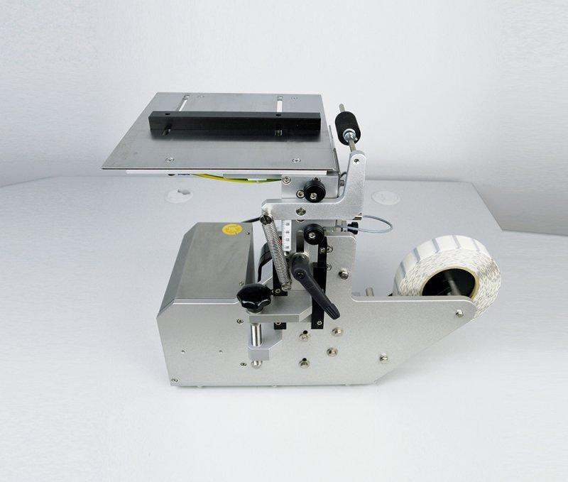 manual tamper evident labelling M-TE - manual tamper evident labelling of folding boxes - M-TE