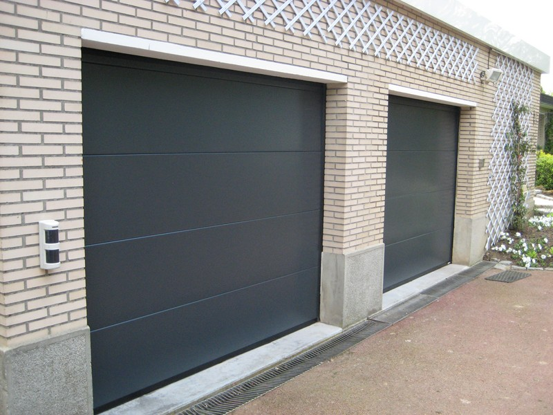 Portes de garage entreprises for Porte de garage sectionnelle haut de gamme