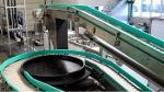 Hinged belt serpentine conveyor