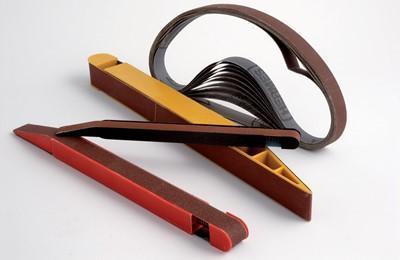 Flexible endless abrasive belts + holder