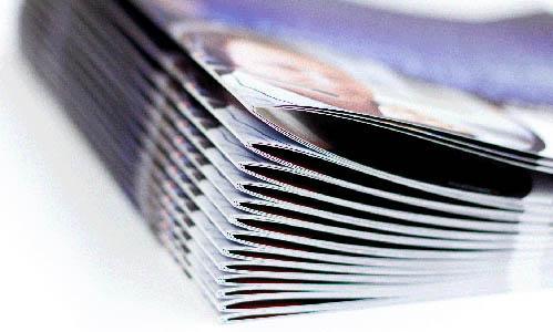 Folletos publicitarios impresos, catálogos cosidos
