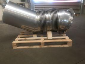 Exhaust expansion joint  with a bend segment