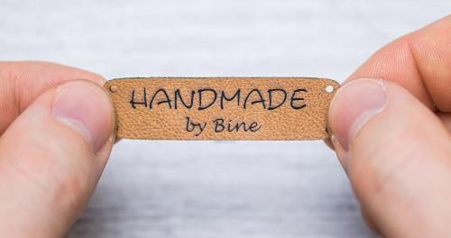 Laser-engraved artificial leather hangtags