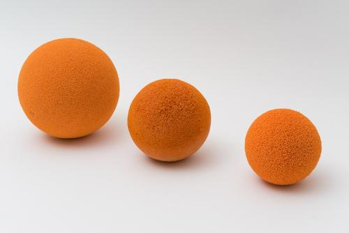 Tube cleaning balls in foam