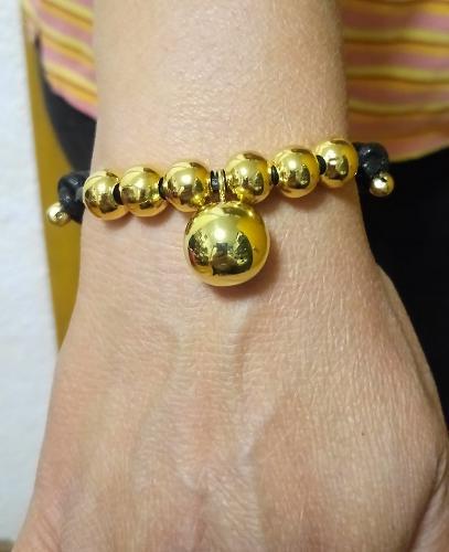 Pulsera piel ajustable con bola musical y bolas Oro laminado