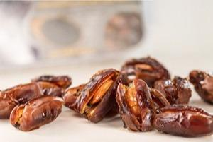 Khudri dates with almonds in honey with black cumin seeds