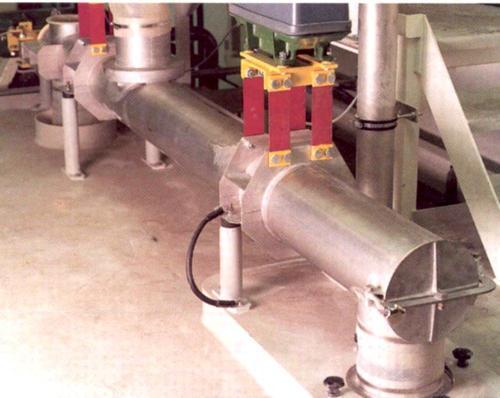 Reversable trough/tubular conveyor