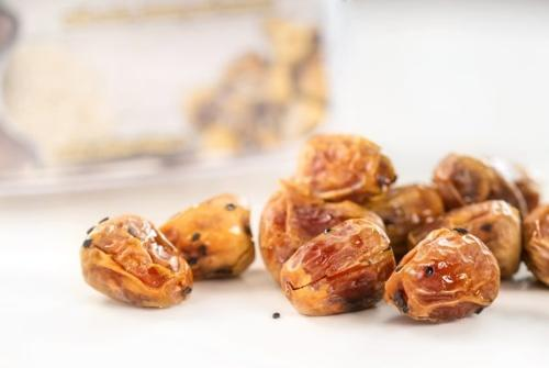 Sukkari dates with hazelnuts in honey with sesame sprinkling