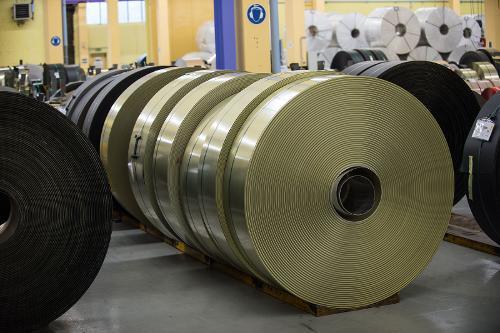 Plastic-coated metal strips