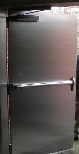 Porte métallique pleine type basculante