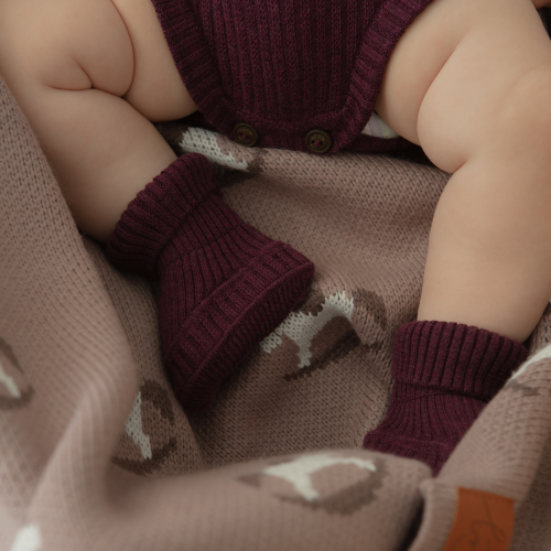 Booties knitted from merino wool Plum