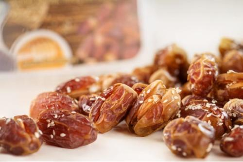Sagai dates in honey with almonds and sesame sprinkling