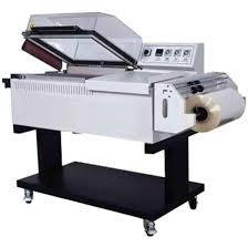 Machine pour emballer sous film rétractable