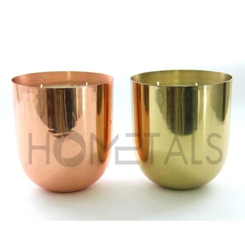 Large size candles in rose gold and golden candle containers