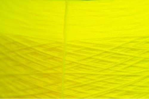 Dyed high-elastic PES Yarns